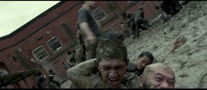 mass fight scene in prison, raid 2